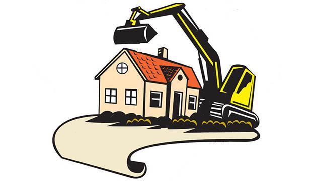 Bulldozer destroying a house
