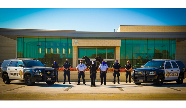 UTA Police officers and vehicles in front of new entrance to the University Center