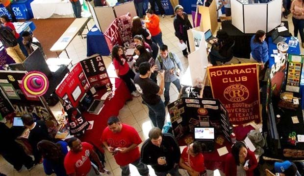 Overhead view of Activity Fair showing people at information booths.