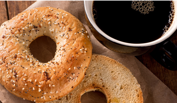 Bagels and coffee on a table.