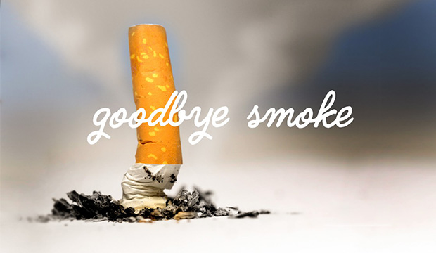 """A crushed out cigarette with words """"Goodbye, Smoke"""""""