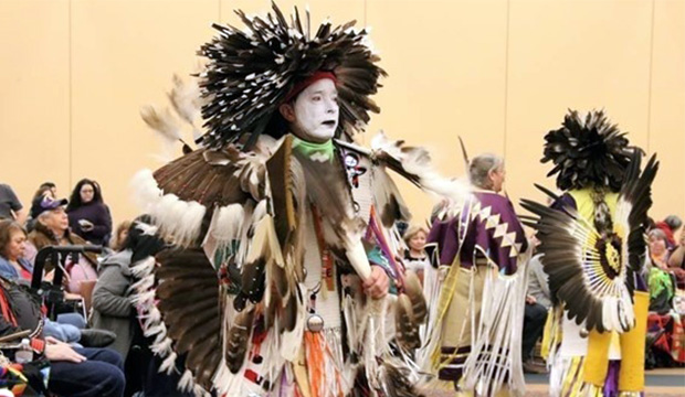 Native American in powwow regalia