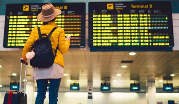 international traveler in front of schedule
