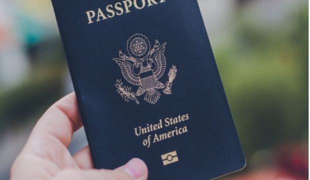 Hand holding a U.S. passport