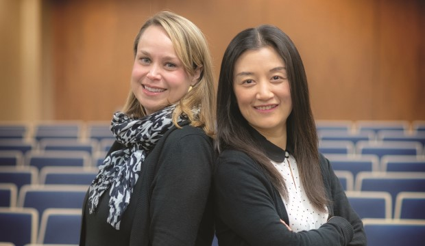 Noelle Fields and Ling Xu, assistant professors in the School of Social Work