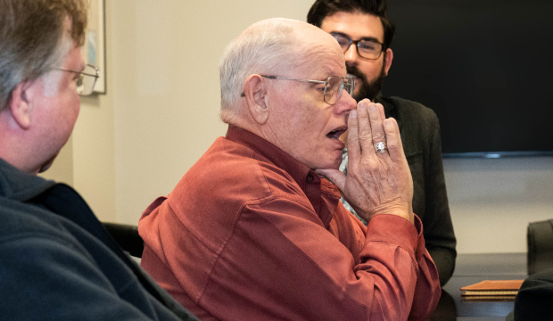Steve Kennedy reacts with surprise when he learns he will receive his UTA diploma 50 years after attending.