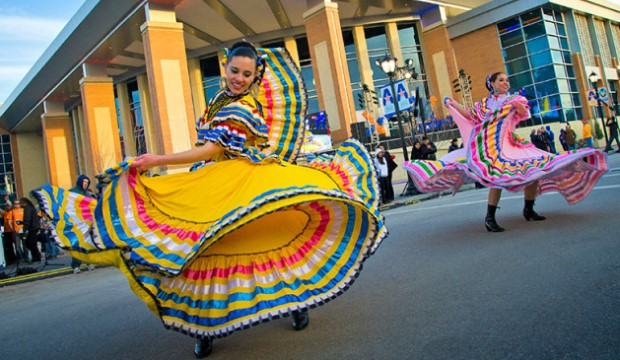Female Mexican dancers is brightly colored dresses