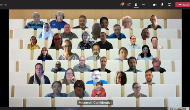 Microsoft Teams' Together Mode shows individuals as if they are in stadiium seating.