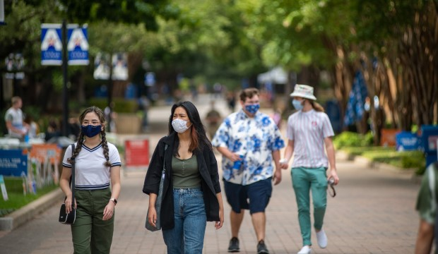 Masked sudents on UC mall