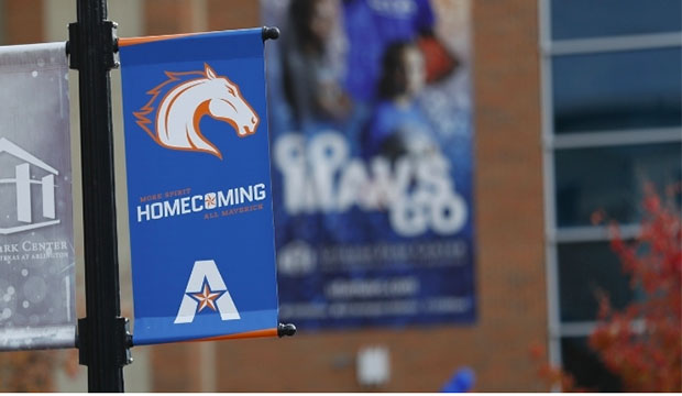 Homecoming banner in front of College Park Center.
