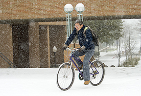 bicyclist in snow