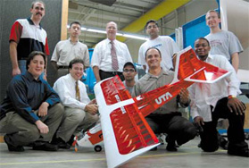 Team of students and faculty with their unmanned aerial vehicle.