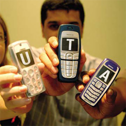 cellphones spelling out U-T-A
