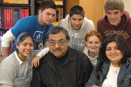 Photo of Chris Gomez with students