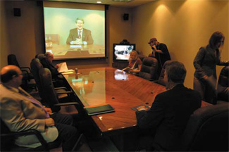 Photo of teleconference between UT Arlington President James D. Spaniolo and UT Dallas President David Daniel
