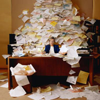 An overflow of papers on a desk