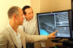 Associate Professor Andrew Makeev shows Faculty Research Associate Yuri Nikishkov